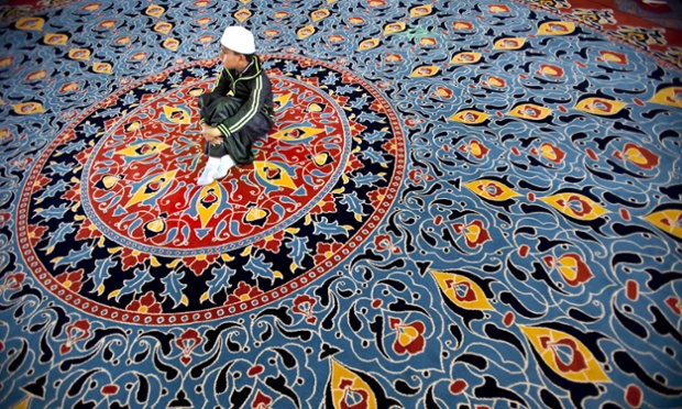 A child attends prayers at the Mosque in the Nizamiye Complex in Midrand, South Africa. The Complex was officially opened by President Jacob Zuma and it contains the largest Turkish Mosque in the Southern Hemisphere.