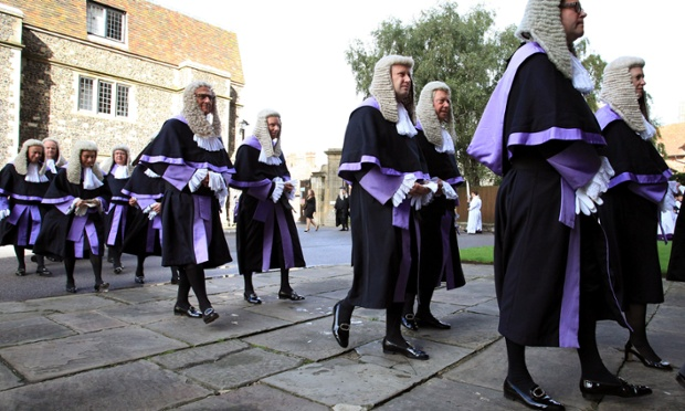 Nice shoes!: Judges proceed into Canterbury Cathedral in Canterbury, Kent, for the 2012 Justice Service.