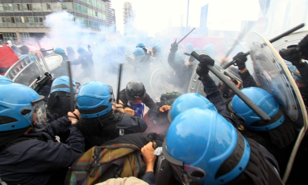 Students protesting against austerity measures clash with riot policemen during a protest march in Milan, Italy.