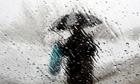 A man walking with an umbrella