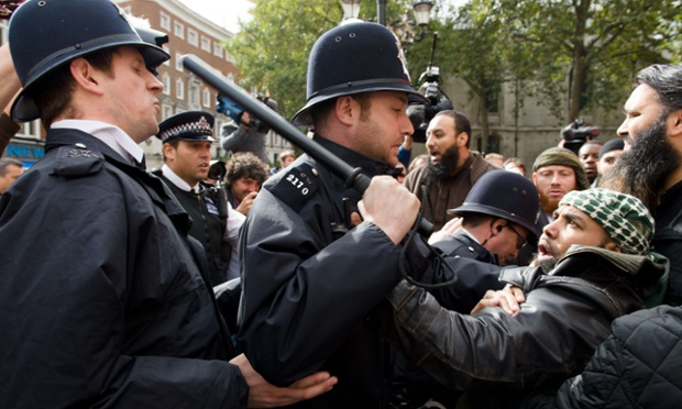 Police clash with supporters of Abu Hamza after members of the group stole a placard from a man who was calling for the extradition of Hamza  outside the High Court in London.