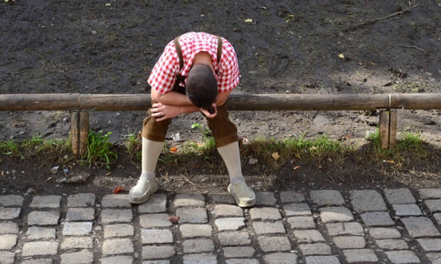 One too many: Oktoberfest drinker has a rest at the Theresienwiese in Munich, Germany. The world famous beer festival, is excepted to attract around six million visitors.