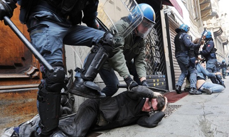 Italian riot police detain demonstrators during a student protest in Turin, Italy, 05 October 2012. Police arrested several people when scuffles broke out as students protested against austerity measures.