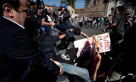 Students clash with riot police in downtown Rome on October 5, 2012.