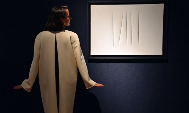 Perfect match: a jacket by Italian designer Mila Schon as she views 'Concetto Spaziale' by Italian artist Lucio Fontana at Christie's auction house in London.