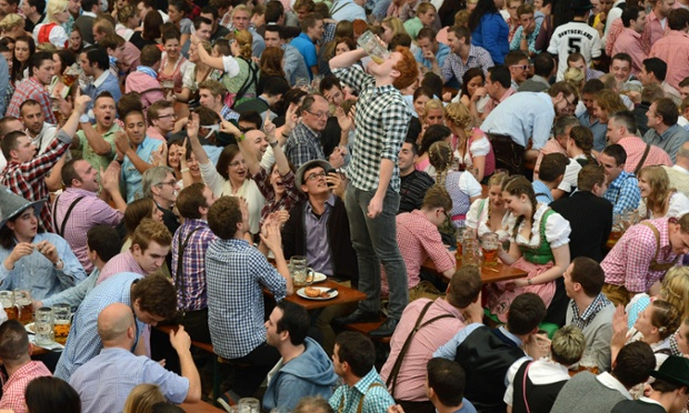 More action from Oktoberfest. Visitors drink beer in a festival tent at the Theresienwiese in Munich, southern Germany.