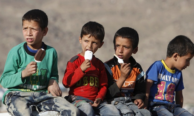 Afghan boys eat ice cream at the outskirts of Kabul.