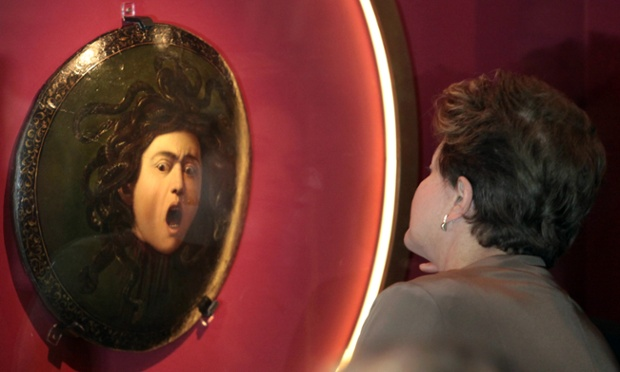 Shocking: Brazil's president, Dilma Rousseff, looks at the oil painting Medusa Murtola by Italian artist Michelangelo Merisi da Caravaggio during the opening of Caravaggio at the Planalto presidential palace in Brasilia, Brazil. Photograph: Eraldo Peres/AP