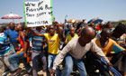 Striking miners march near the Anglo American Platinum mine in Rustenburg, South Africa