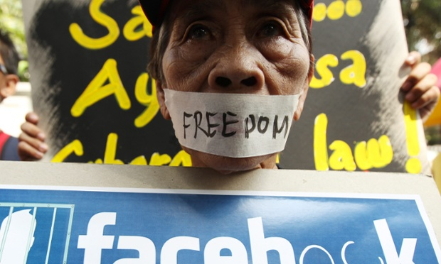 A Filipino protester joins a protest rally against the implemetation of 'Cybercrime Prevention Act' in front of the Supreme Court in Manila, Philippines.