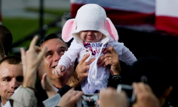 The other presidential candidate Mitt Romney holds up a baby during a rally in Newport News, Virginia, on October 8, 2012.