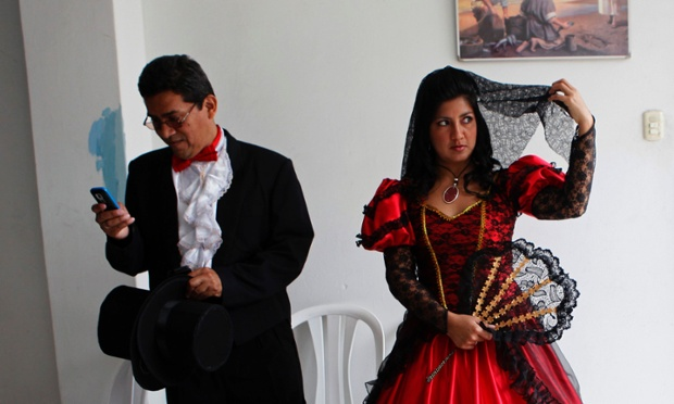 A couple wearing traditional dress wait for the start of a mass wedding ceremony, in the district of Comas in Lima, Peru. Some 60 couples wearing traditional outfits tied the knot in the mass wedding ceremony organised by Comas city officials to promote family integration and cultural diversity.