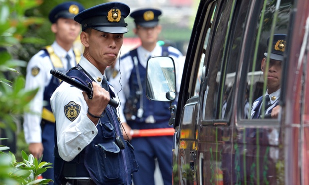 A policeman checks a van at a checkpoint near the venue of the International Monetary Fund and World Bank Group annual meeting in Tokyo. Some 20,000 government and institution officials, including IMF chief Christine Lagarde, will gather for the IMF and the World Bank Group annual meetings in Tokyo from October 9 to 14.