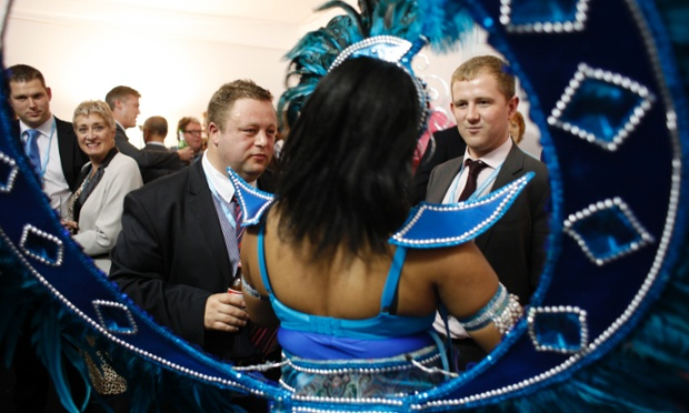 Carnival conference: Delegates at the Conservative party gathering in Birmingham talk to carnival performer Veronia during a special event celebrating the diversity of the town of Luton.