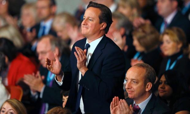 Prime Minister David Cameron stands as he applauds the keynote speech from London Mayor Boris Johnson.