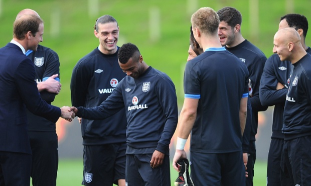 Prince William shares a joke with Ashley Cole of England team at St Georges Park in Burton-upon-Trent.