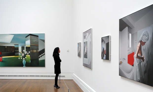 A gallery staff member looks at works by the late British artist Richard Hamilton at the National Gallery in London.