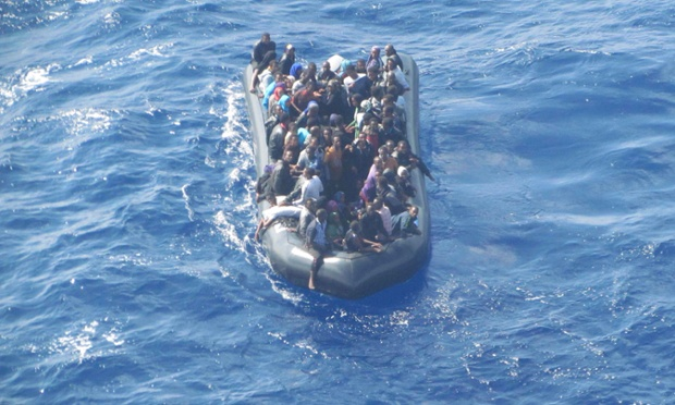 Some 93 immigrants are seen crammed onto a rubber dinghy filmed from a Guardia di Finanza police helicopter near the southern coast of the Sicilian island of Lampedusa