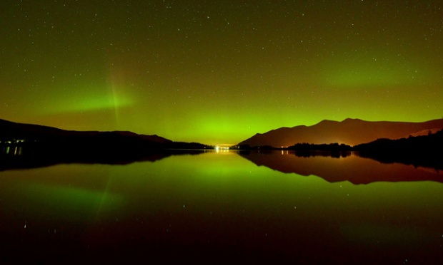 This may look like a scene from a Norweigan fjord but its actually the Lake District in Cumbria, where the Aurora Borealis appears during a geomagnetic storm in the skies behind the lakeland fell of Skiddaw and is reflecting its neon green glow into the glass-like waters of Derwentwater, near the Cumbrian town of Keswick.