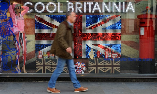 A pedestrian walks past a Cool Britainnia shop in central London. The IMF has forecast that the British economy will shrink by 0.4 percent in 2012.