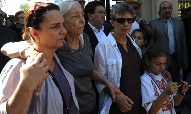 Claudine Chaulet, centre and her two daughters attend the funeral procession of her husband, late Algerian anti-colonialist militant Pierre Chaulet, in Algiers. Chaulet died at age of 82 in France on October 5, following a battle against cancer.