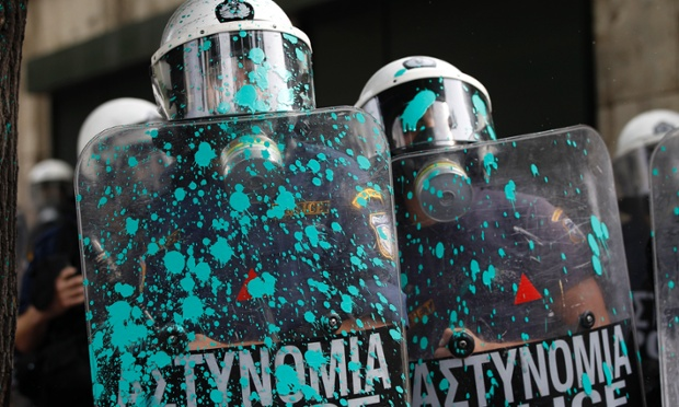 Riot police shields are splattered with paint thrown by protesters after the protest in front of the parliament in Athens.