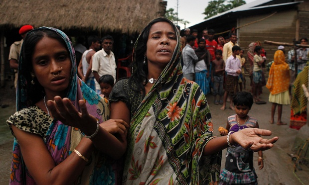 Rukiya Khatoon mourns her two children who died when a boat capsized in floodwaters, at Patekibori village, about 50 miles east of Gauhati, India. Five school students drowned in two separate boats capsizes in the northeastern Indian state of Assam, while 12 others were either rescued or swam to safety, police said.