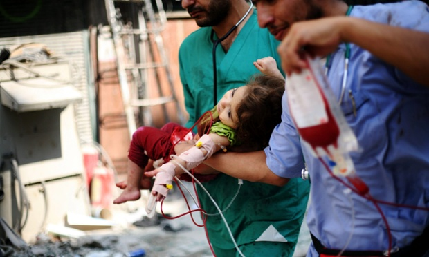 Medics carry a Syrian child who was injured in government shelling on rebels  controlled areas of Aleppo.