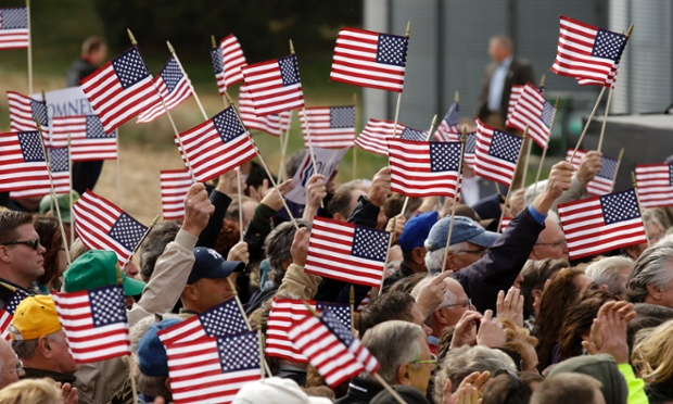Flag-fest: Supporters wave flags as Republican presidential candidate, former Massachusetts Gov. Mitt Romney speaks during a campaign stop at the Koch Family Farm in Van Meter, Iowa.