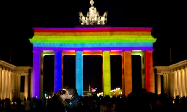 Kissing gate: A couple kiss as they photograph themselves in front of Berlin's landmark Brandenburger Gate being illuminated as the technicians test the the lights on the eve of the opening of the yearly
