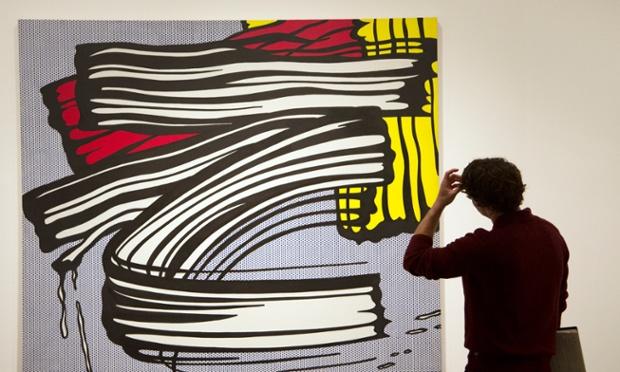National Gallery of Art patron Ari Post looks at a Roy Lichtenstein's artwork