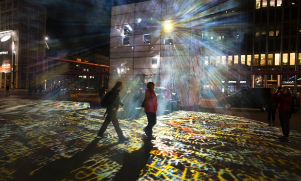 Shining path: People walk through a light installation at the Potsdamer Platz during a rehearsal of the ninth Festival Of Lights in Berlin. During the festival which runs from Oct. 10, until Oct. 21, 2012, about 70 buildings and landmarks of the German capital will be special illuminated.