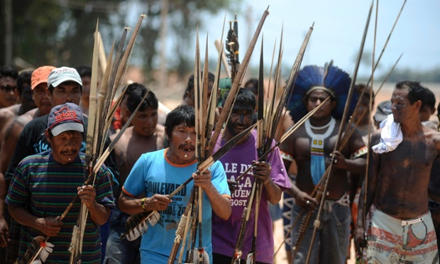 Dozens of Amazonian Indians, fishermen and local residents block heavy machinery being used to construct the Belo Monte hydroelectric dam in Vitoria do Xingu near Altamira. Some 150 people opposed to the dam and its ecological impact and displacement of local villages paralyzed the construction during the night, forcing workers to leave their posts, according to the leaders of the protest.