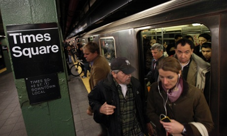 Passengers exit a downtown-bound subway train in New York's Times Square. The city moved closer to resuming its frenetic pace by getting back its vital subways, three days after a superstorm, but neighboring New Jersey was stunned by miles of coastal devastation and the news of thousands of people in one city still stranded by increasingly fetid flood waters.