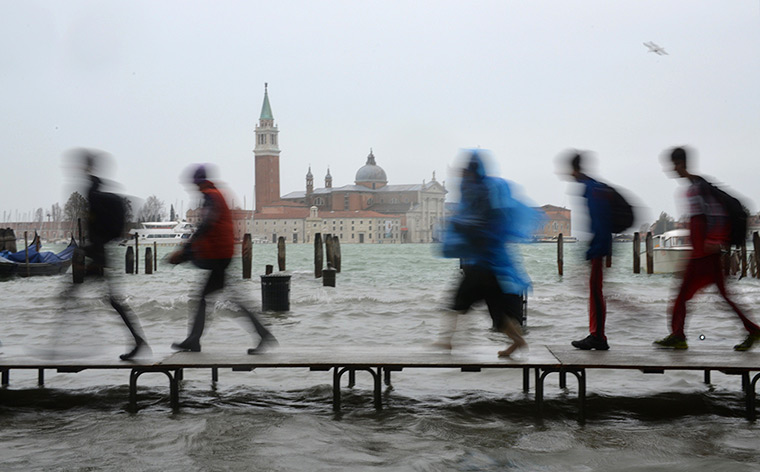 Venice floods: Tourists walk on wooden walkways