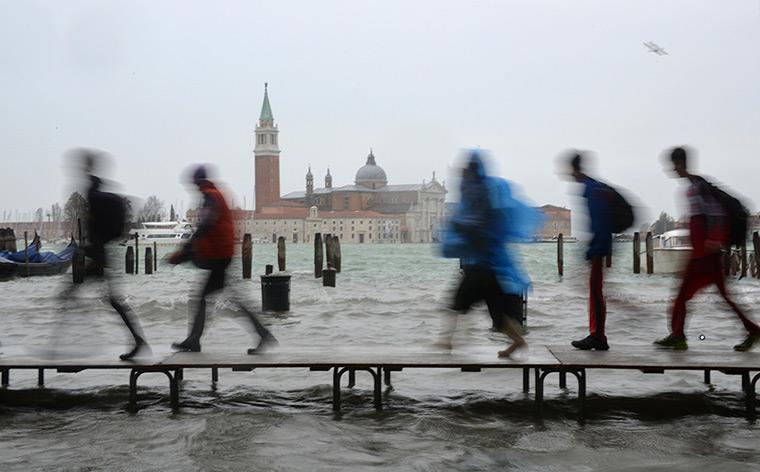 Venice floods: Tourists walk on wooden walkways