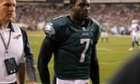 Philadelphia Eagles quarterback Michael Vick leaves the field with a concussion during his team's loss to the Dallas Cowboys.
