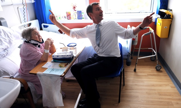 All together now … the health secretary, Jeremy Hunt, looks to be providing the entertainment as he meets Monica Kneebone, a patient at King's College hospital in London