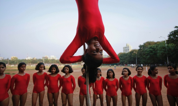 Up to clever tricks: a girl practises a Mallakhamb pose while suspended from a rope in Mumbai. Mallakhamb is an ancient Indian sport which originated as a complementary exercise for wrestling, but is now practised as a sport in itself. Practitioners say the sport not only develops a healthy and strong body, but also strengthens willpower and helps compose the mind