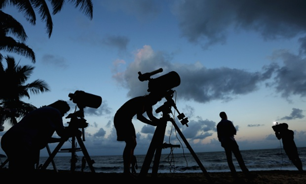 Photographers set up on Palm Cove in preparation to run a live stream via Nasa of the expected total solar eclipse in  Cairns, Australia. Thousands have gathered in this part of north Queensland to enjoy the solar eclipse, the first to be seen in Australia in a decade