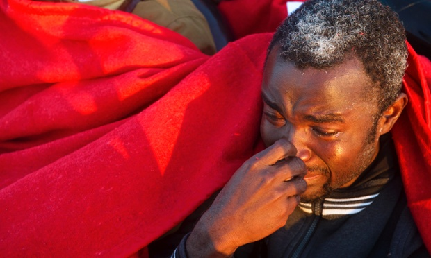A migrant reacts after being rescued off the Spanish coast. Emergency services and the Red Cross intercepted an inflatable boat carrying 10 sub-Saharan migrants trying to cross the Strait of Gibraltar, six miles from Tarifa, off the coast of southern Spain