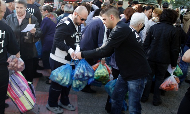 Supporters of Greece's ultra nationalist party Golden Dawn distribute food in Athens. Golden Dawn has seen a recent surge in its popularity, with its rightwing political views on unemployment, austerity cuts and immigration appealing to Greek citizens suffering in the current economic climate
