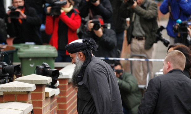 Photographers focus on Abu Qatada returning to his home in north-west London. The conditions of his bail impose a curfew from 4pm to 8am enforced by an electronic tag and restrictions on who he can meet