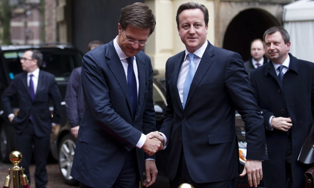Looking a little more buttoned-up than he did last night, David Cameron is welcomed by Dutch prime minister Mark Rutte at the Binnenhof, in The Hague, Netherlands. The leaders are meeting to prepare themselves for EU summits in November and December