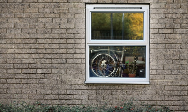 A folded Brompton bicycle rests in a window of its factory in Brentford, London. Brompton is one of only two major bike frame manufacturers still based in the UK, creating all their folding bicycles in west London. The original Brompton patent was filed in 1979 by the inventor Andrew Ritchie and the basic design remains largely unchanged