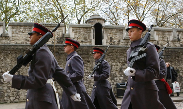 Soldiers march at the Tower of London where police are investigating how an intruder breached the walls and stole a set of keys from the tourist attraction which is home to the crown jewels. Locks to the Tower's drawbridges and other rooms have been changed after the man was caught trespassing in the early hours of 6 November and escorted from the premises, according to a royal palaces statement