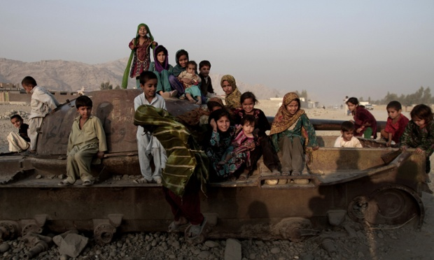 The remains of an old Soviet tank make an unusually effective prop for this portrait of children taken on the outskirts of Jalalabad east of Kabul in Afghanistan.