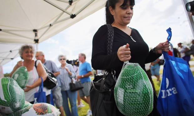 Janet Avila walks away with the turkey she received at a turkey give-a-way, as people prepare for the upcoming Thanksgiving holiday in Doral, Florida. The event was put on by the City of Sweetwater and the Miami Dade League of Cities to distribute turkeys and non-perishable items in Miami-Dade County.