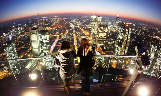 Tourists enjoy a skyline view from the top of the Main tower in Frankfurt, Germany.