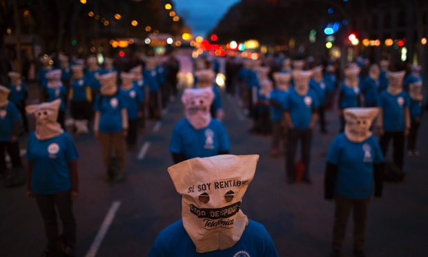 A lack of communication - as workers from Telefonica phone company protests against the unjustified dismissals at their company ahead of a general strike in Barcelona, Spain. The masks reads in Spanish:
